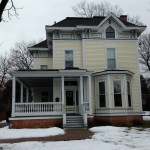 Before-  Failing aluminum storms clash with 1870's home